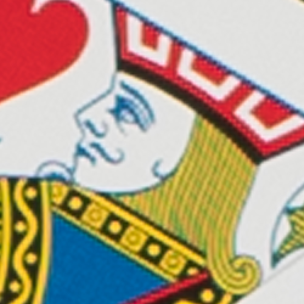 Close up image of a playing card with a jack that is pixelated.